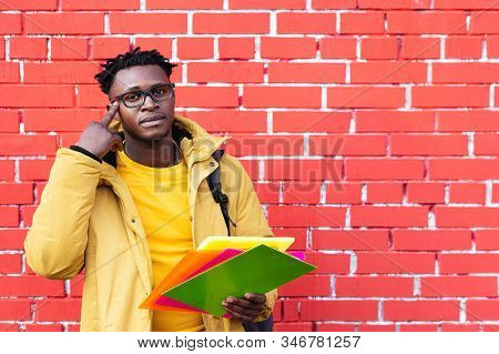 African American man thinking about studying science brainstorming stock photo