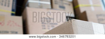 Pile of brown cardboard boxes at warehouse of market. Different stuff packed in carton boxes. Moving concept. Set of cargo boxes ready for delivery. stock photo