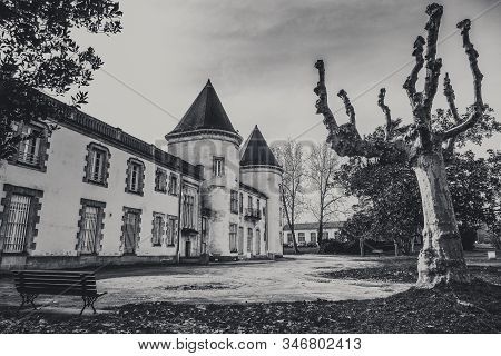 Ancient castle chateau de Thouars in South West of France viewed from the public street in winter. Black and White Style. stock photo