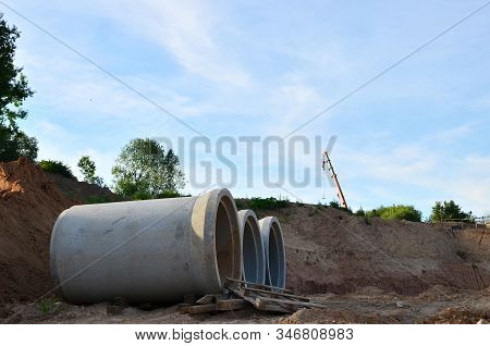 Laying or replacement of underground storm sewer pipes. Installation of water main, sanitary sewer, storm drain systems in city. Concrete drainage pipe. Utility Infrastructure - Image stock photo