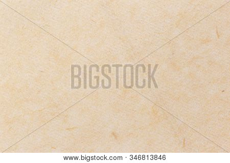 Brown paper texture or paper background. Seamless paper for design. Close-up paper texture for background. Abstract recycled paper. Empty paper texture background. Highly detailed paper background. Grunge paper for design. stock photo