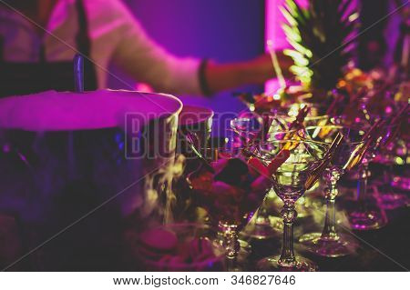 View of alcohol setting on catering banquet table, row line of different colored alcohol cocktails on a party, martini, vodka, and others on decorated catering bouquet table event stock photo