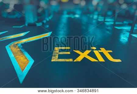 Exit background, big yellow arrow to exit from subway, direction sign, conceptual imahe of the way out, urban life, modern underground system  stock photo