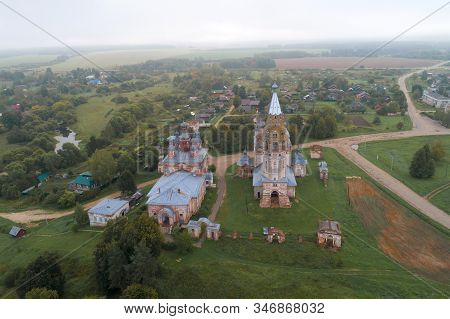 View of two abandoned ancient Orthodox churches on a foggy September morning (aerial photography). Village Parskoe. Ivanovo region, Russia stock photo