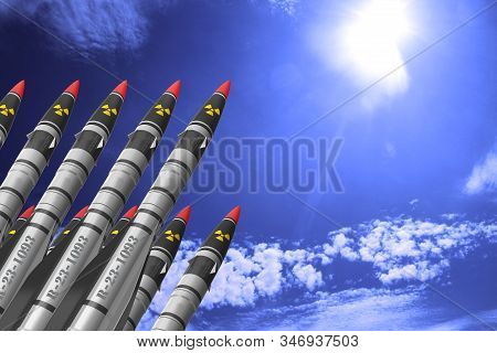 Atomic rockets earth - air directed up against a bright sky with white clouds. The concept of atomic warfare. stock photo