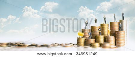 Miniature people standing on stack of coins. Inequality and social class. Income and economic inequality concept. Inequality in social class, ideology, Gender, Racial and ethnic and health. stock photo