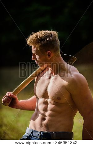 Strength and power concept. Forester with axe. Sexy macho bare torso. Surviving in wild nature. Muscular athlete in forest. Sport and fitness. Muscular body. Handsome shirtless man muscular body stock photo