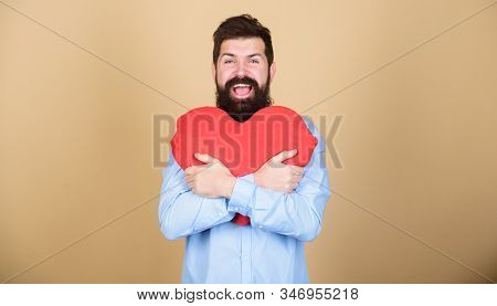 Feeling love. Dating and relations concept. Happy in love. Make him feel loved every day. Man bearded hipster hug heart. Celebrate valentines day. Guy with beard and mustache in love romantic mood stock photo