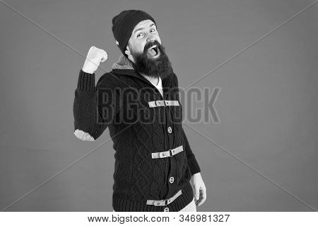everyday winner. get warm and comfortable. hipster mens jacket. happy man autumn style. beard care in winter. male fashion. brutal man knitted hat. knitted hat accessory. bearded man knitwear sweater. stock photo