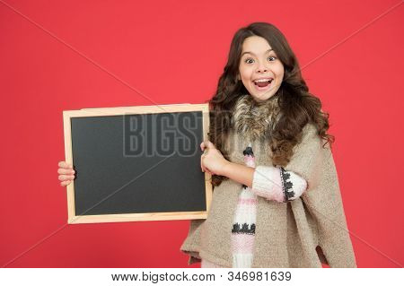 Announcement board. Profitable deal. Happy girl blank blackboard. copy space. Important information. Winter activity advertisement. Time for winter holiday. Useful info. Winter shopping sales. stock photo
