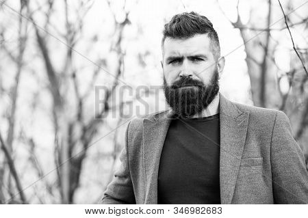 Fine grooming for modern savage. Bearded man with brutal beard. Hipster wear long beard and mustache in brutal style. Lumberjack look of modern businessman. Brutal and bearded. Barbershop. stock photo