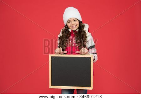 Time for winter holiday. Winter shopping sales. Skating rink. Active leisure. Happy hours. Announcement. Happy girl blank blackboard copy space. Important information. Winter activity advertisement. stock photo