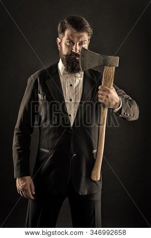 Barbershop hairstyle. Brutal barber. Brutal manners. Resoluteness concept. Own opinion. Decision was made. Man brutal hipster with axe. Sharp ax hand confident guy. Masculinity and brutality. stock photo
