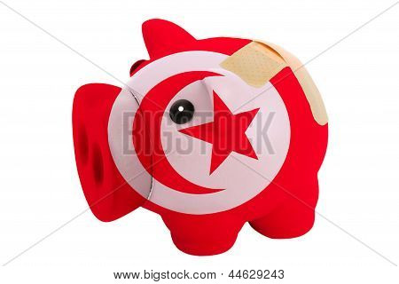 epty poor man piggy rich bank in colorsnational flag of tunisia on white stock photo