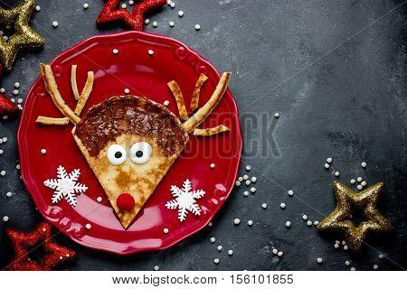 Reindeer pancakes recipe. Christmas fun food for kids. Reindeer pancake for breakfast