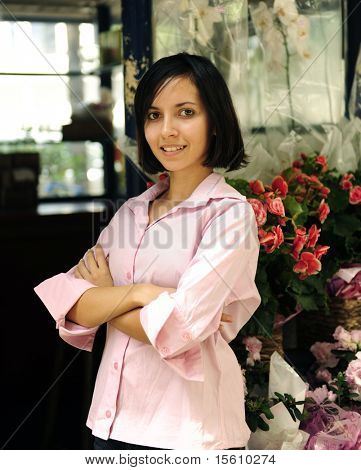 small business owner: proud woman and her flower shop stock photo