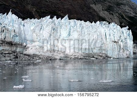 Margerie glacier and icebergs reflecting in clear ocean water in Glacier Bay National Park stock photo