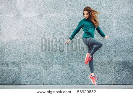 Fitness sport girl in fashion sportswear doing yoga fitness exercise in the street, outdoor sports,