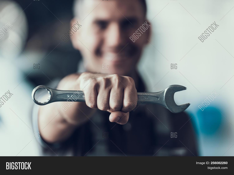 auto,automobile,backround,blue,blurred,bonnet,business,car,caucasian,checkup,clipboard,concept,day,engine,expertise,fist,fix,garage,inspection,job,machinist,maintenance,man,master,mechanic,mechanical,occupation,portrait,professional,repair,repairman,service,shop,smiling,smith,spanner,technic,technician,tire,tool,uniform,using,vehicle,wear,work,worker,wrench,young