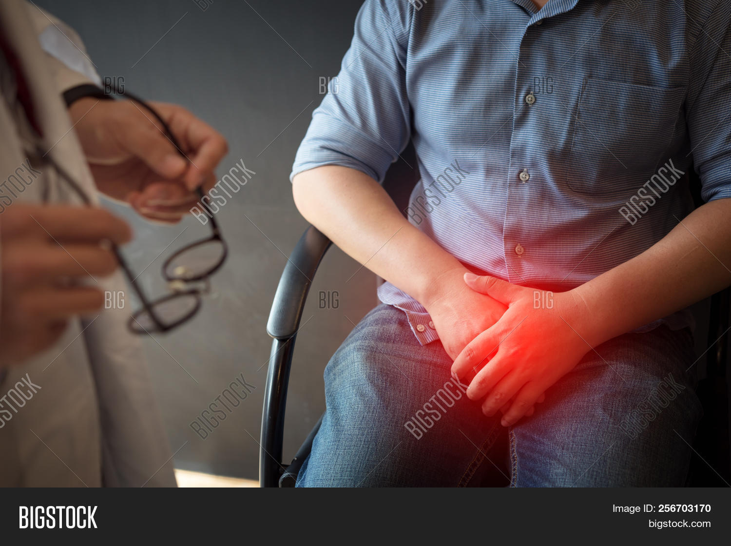 Male Doctor And Testicular Cancer Patient Are Discussing About Testicular Cancer Test Report. Testic