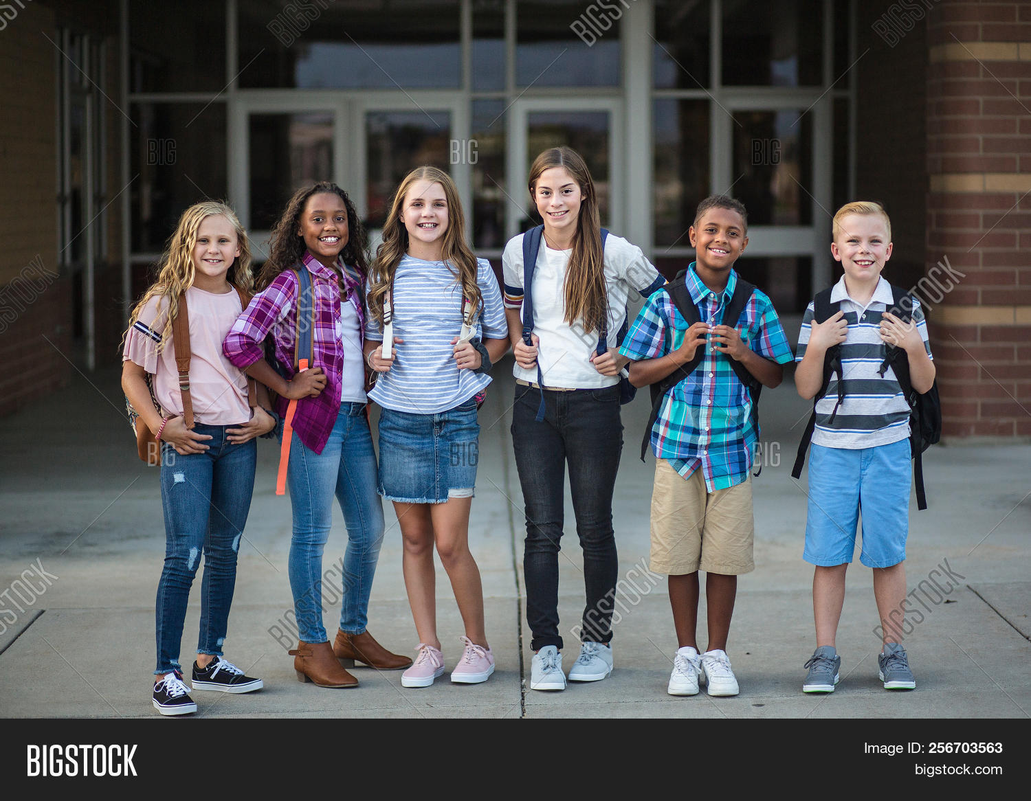 adolescent,african american,athletic,background,backpack,black,boy,boys,building,cheerful,childhood,children,class,classmate,classmates,copy space,cute,diverse,diversity,education,elementary school,ethnicity,female,friends,friendship,girls,grade school,group,hanging out,happy,hispanic,junior high,kids,learning,lifestyle,people,portrait,pre-adolescent,real,school,school kids,smiling,standing,students,teen,teenage,togetherness,toothy,tween,young
