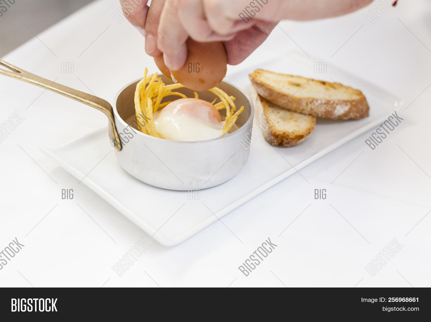 🔥 Chef´s Hand Breaking An Egg Plating A Gourmet Dish Consisting On