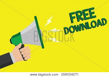 Text sign showing Free Download. Conceptual photo Key in Transfigure Initialize Freebies Wireless Images Man holding megaphone loudspeaker yellow background message speaking loud. stock photo