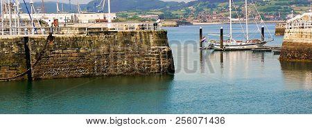 Boats on the coast of the bay of Gijón, Asturias. Spain. Europe stock photo