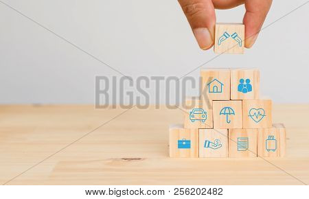 Insurance Concept, Hand Man Try To Put The Insurance To Protect Or Cover Person, Property ,liability