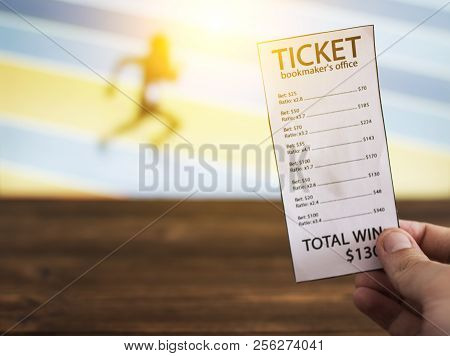 Bookmaker ticket on the background of the TV, which shows athletics, running, jumping, sports betting, Bookmaker ticket stock photo
