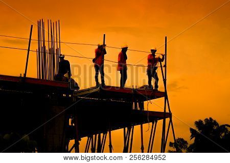 Engineers are consulting before ordering construction work on site. Construction teams are working in heavy industries, ground and safety concepts. stock photo