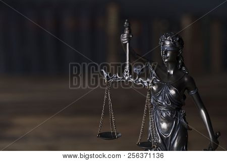 Themis - symbol of the blind justice on dark background. stock photo