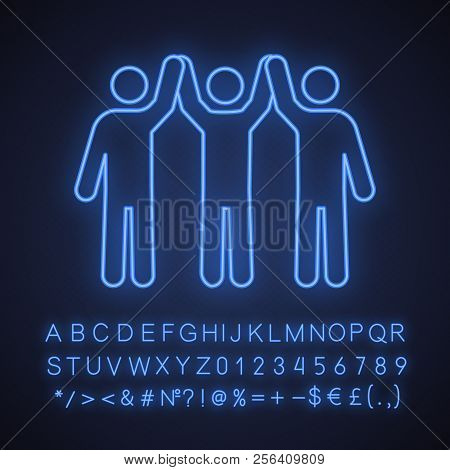 Charity organization neon light icon. Community glowing sign. Unity in diversity. People holding hands up. Teamwork. Charitable foundation. Friendship. Vector isolated illustration stock photo