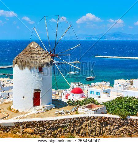 White greek windmilll with straw roof in Mykonos Island, Cyclades, Greece               stock photo
