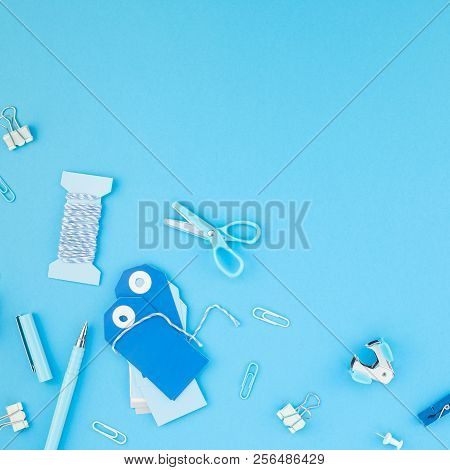 Creative flat lay top view back to school concept with color school and office supplies on bright turquoise paper table frame background with copy space, template for text or design. Long wide banner stock photo
