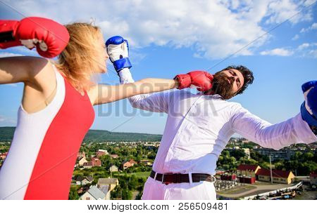 How to win her back effective tips. Let her win concept. Couple boxing gloves fight sky background. Girl confident strength power. Leadership family relations. Things guy can do to make woman happy stock photo