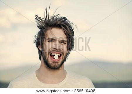 Cold, flu and headache treatment, hypnotic tablet. Drug and antidepressant, insomnia. Dieting pill and vitamin, man with anabolic. Health and medicine, hangover. Man with pills in mouth. stock photo