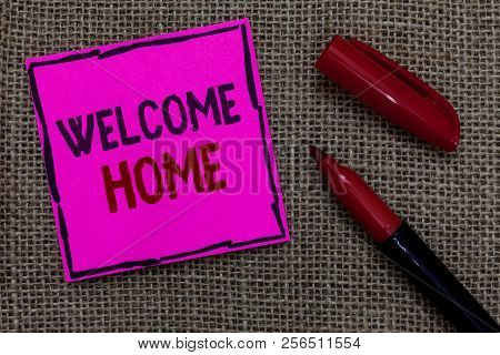 Word writing text Welcome Home. Business concept for Expression Greetings New Owners Domicile Doormat Entry Pink paper Important reminder Marker Communicate ideas Jute background. stock photo
