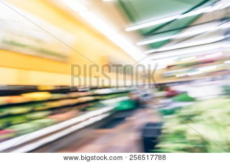 Blurred image people shopping at local Latino-American supermarket chain in USA. Customer buying fresh fruits, vegetables. Organic locally grown produces on display. Healthy food in grocery store stock photo