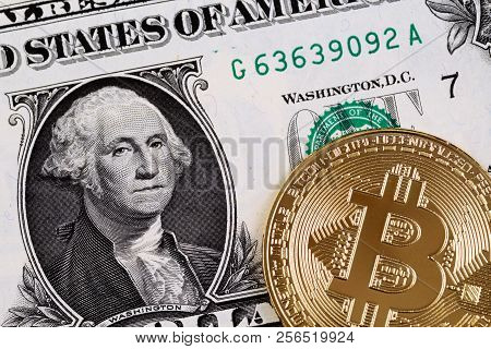 A close up image of an American one dollar bill with a golden bank note stock photo
