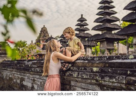 Mom and son tourists in Traditional balinese hindu Temple Taman Ayun in Mengwi. Bali, Indonesia Traveling with children concept stock photo