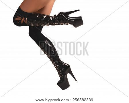 Sexy female tanned legs in stocking and shiny black fetish boots with extrem platform sole, side view, isolated stock photo