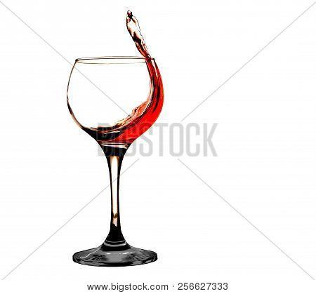 Red wine splash at white backgraund action stock photo