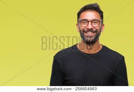Adult hispanic man wearing glasses over isolated background with a happy and cool smile on face. Lucky person. stock photo