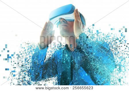 A Person In Virtual Reality Glasses Flies To Pixels. The Concept Of New Technologies And Technologie