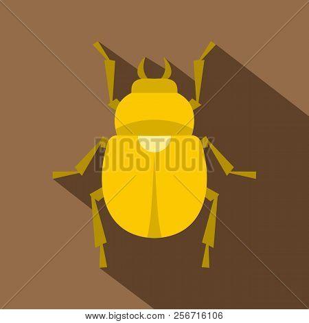 Gold scarab beetle icon. Flat illustration of gold scarab beetle icon for web isolated on coffee background stock photo