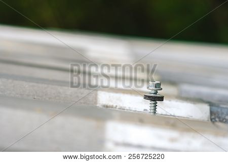 gray corrugated metal cladding on industrial building roof stock photo