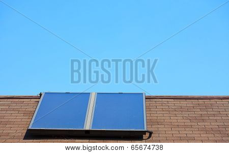 Renewable regenerative power and energy. Closeup of solar panel on troof of house. System of electricity generation. stock photo
