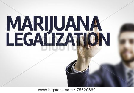 Business man pointing to transparent board with text: Marijuana Legalization  stock photo