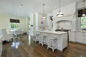 Large kitchen in extravagance home with white cabinetry